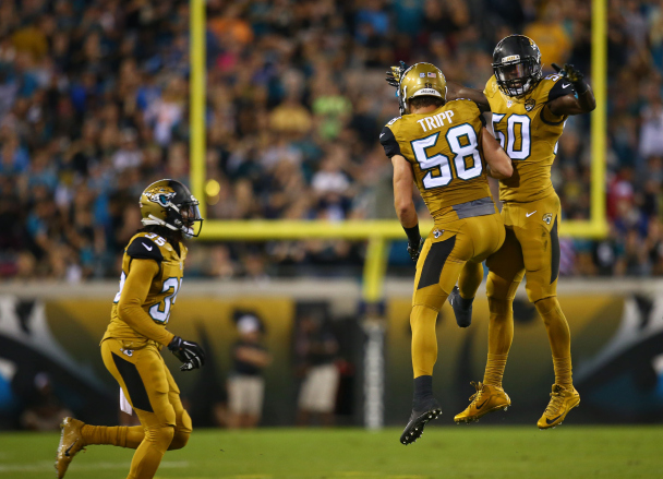 JACKSONVILLE, FL - NOVEMBER 19: Telvin Smith #50 and Jordie Tripp #58 of the Jacksonville Jaguars celebrate after a play during the first half of the game against the Tennessee Titans at EverBank Field on November 19, 2015 in Jacksonville, Florida.  (Photo by Rob Foldy/Getty Images)
